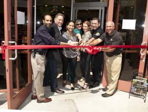 A ribbon-cutting ceremony with the staff