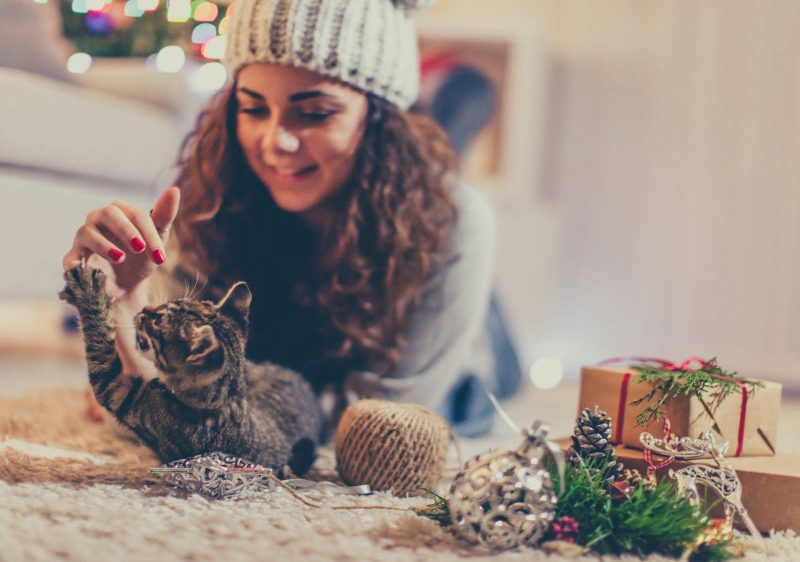 Playing with her cat for Christmas